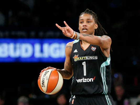 "FILE - In this June 7, 2017 file photo, New York Liberty guard Shavonte Zellous (1) gestures in the second half of an WNBA basketball game against the Atlanta Dream in New York. Zellous is thrilled that the New York Liberty will have a float in Sunday's pride parade, the first for a sports franchise in the city. ""I'm excited. I haven't been in a pride parade before, so I think I'm more excited than most,"" said Zellous, a guard who wore rainbow-colored shoes Friday night, June 23 for the Liberty's pride game. (AP Photo/Kathy Willens, File)"