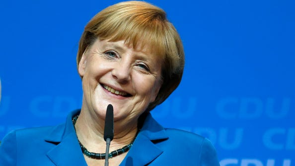 German Chancellor Angela Merkel, chairwoman of the Christian Democratic party CDU, smiles as she talks to her supporters at the party headquarters in Berlin on Sunday. ARD and ZDF television projections Sunday showed a wide lead for Merkel's conservative Union bloc over challenger Peer Steinbrueck's Social Democrats.  (AP Photo/Matthias Schrader)
