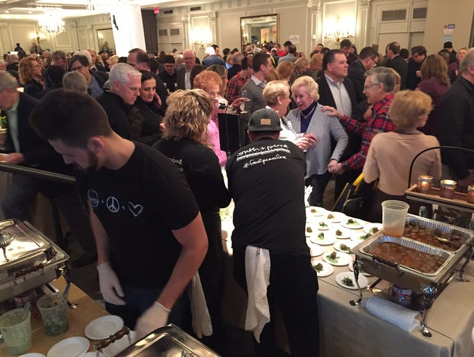 Crowds enjoy food and wine from the many vendors in