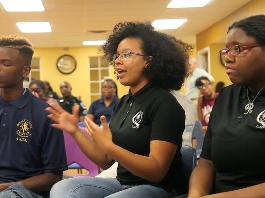 Angel Escobar, 17, center, of Quality Life Center,
