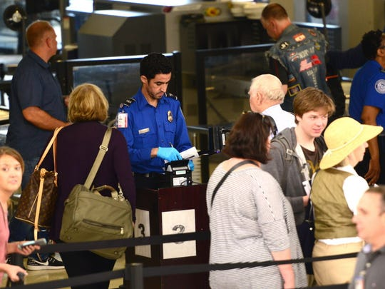 Passengers go through the TSA checkpoint in Terminal C at Newark Liberty Airport.
