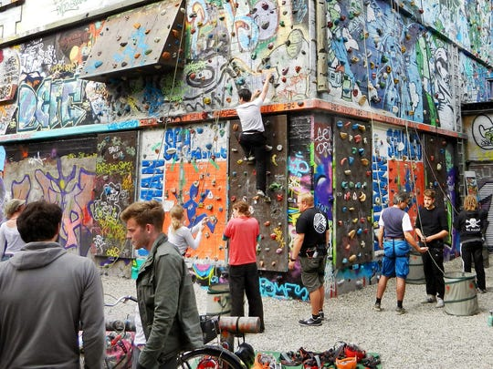 Hamburg creatively recycles its urban past: This graffiti-covered WWII bunker is now the largest climbing wall in the city.