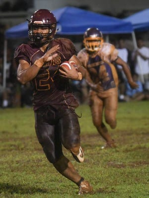 In this file photo, De'Aundre Cruz, running back for the Father Duenas Friars, breaks loose for big yardage against the George Washington Geckos.