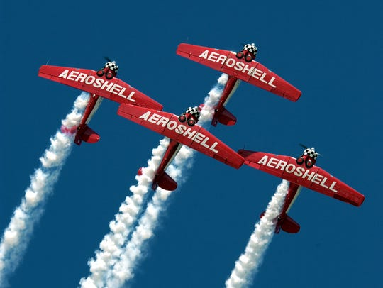 The Aeroshell Aerobatic Team gets into formation.