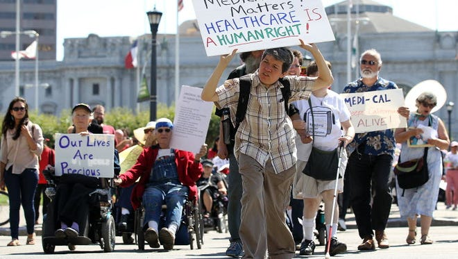 Disabled people protest cuts to Medicaid in San Francisco.