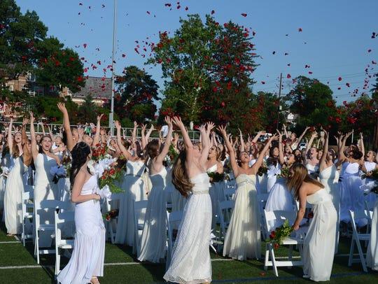 Graduating young women at Ridgewood High School throw