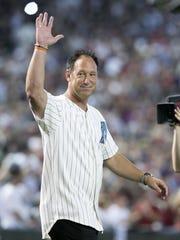 Former Diamondback Luis Gonzalez waves to the crowd