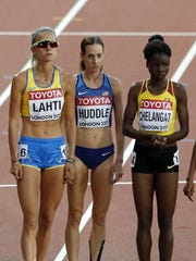 Molly Huddle, center, is pictured with Sarah Lahti, left, and Mercyline Chelangat before the start of Saturdays race.