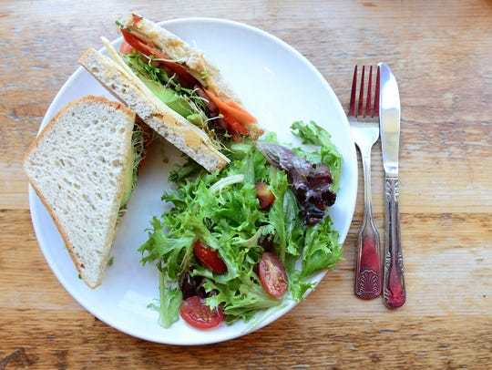 A gluten free option at Nectar Cafe and Juice Bar is the Powerhouse. It features stacked cucumber, avocado, tomato, roasted red pepper, carrots, spinach, havarti cheese on Ezekiel sprouted bread with a hummus spread and a drizzle of lemon olive oil.