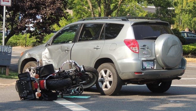 A motorcyclist suffered minor injuries after a SUV driver made an illegal left turn from the right lane into him.