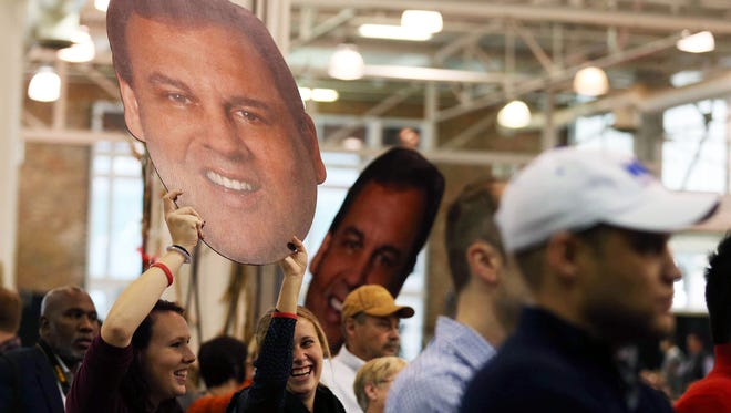 Danielle Bates and Liz Nimmo, both students at Simpson College, hold a Chris Christie cutout during his speech Oct. 31, 2015, at the GOP Growth and Opportunity Party in Des Moines, Iowa.