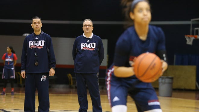 Robert Morris women's basektball coach Sal Buscaglia, center, and his son, Charlie, oversee a recent practice. Soon Charlie will take of the program.