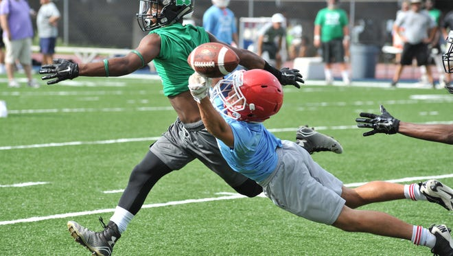 A member of Notre Dame's defense breaks up a pass in the Pios' contest against Lafayette Thursday in the Quick Slants 7-on-7 football tournament.