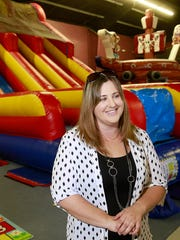 Owner Danie Lambson stands inside Farmington Play Day on Tuesday at 1601 North Dustin Ave., Suite F.