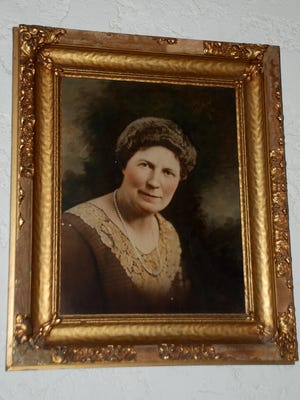 The photograph of Maude Blaney hangs in the main room at Carrizozo Woman's Club to honor the club's first president in 1920. That year the club became affiliated with the International General Federation of Women's Clubs, founded in 1890, one of the world's oldest volunteer service organizations.