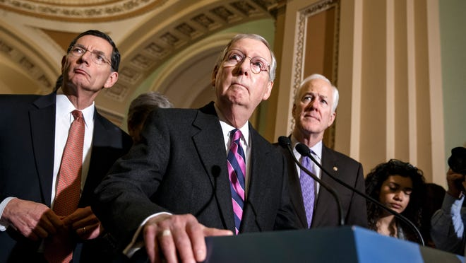 Senate Majority Leader Mitch McConnell of Ky., with Senate Minority Whip John Cornyn of Texas, right, and Sen. John Barrasso, R-Wyo., left, talks with reporters on Capitol Hill in Washington, Wednesday, Jan. 7, 2015, following their first GOP policy meeting since Congress reconvened yesterday. With Congress under full GOP control for the first time in eight years, Republicans are pursuing an ambitious agenda including early votes on bills to advance the long-stalled Keystone XL pipeline and change the definition of full-time work under Obama's health law from 30 hours a week to 40 hours a week. President Obama has threatened to veto both measures. (AP Photo/J. Scott Applewhite)