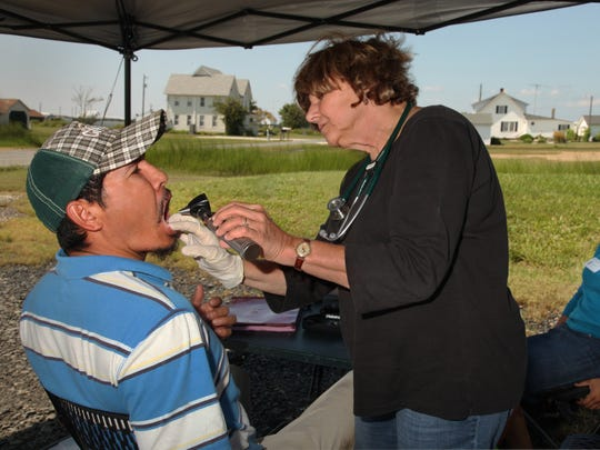 A family nurse practitioner examines a seafood worker