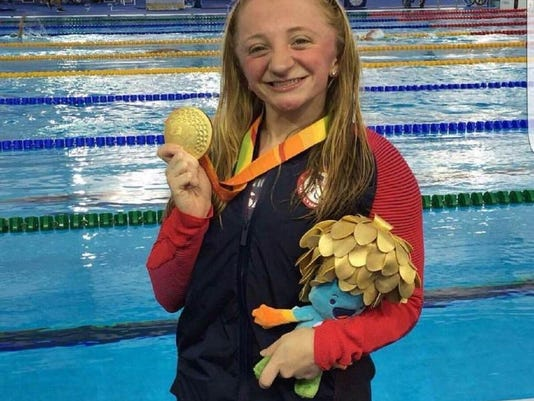 636093735030706345-Paralympian-McKenzie-Coan-with-her-gold-medal-women-s-50-meter-freestyle-from-Rio-de-Janiero-Brazil.jpg