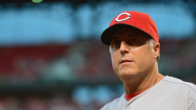 Cincinnati Reds manager Bryan Price (38) looks on as his team plays the St. Louis Cardinals during the second inning at Busch Stadium.