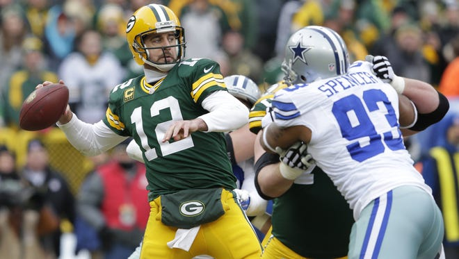 Green Bay Packers quarterback Aaron Rodgers (12) passes the ball in the second quarter.  The Green Bay Packers host the Dallas Cowboys during an NFC divisional playoff game Sunday, January 11, 2015, at Lambeau Field in Green Bay, Wis.  Dan Powers/P-C Media
