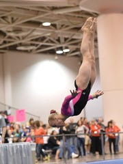 Erika Muhaw of Montville does a floor exercise routine.