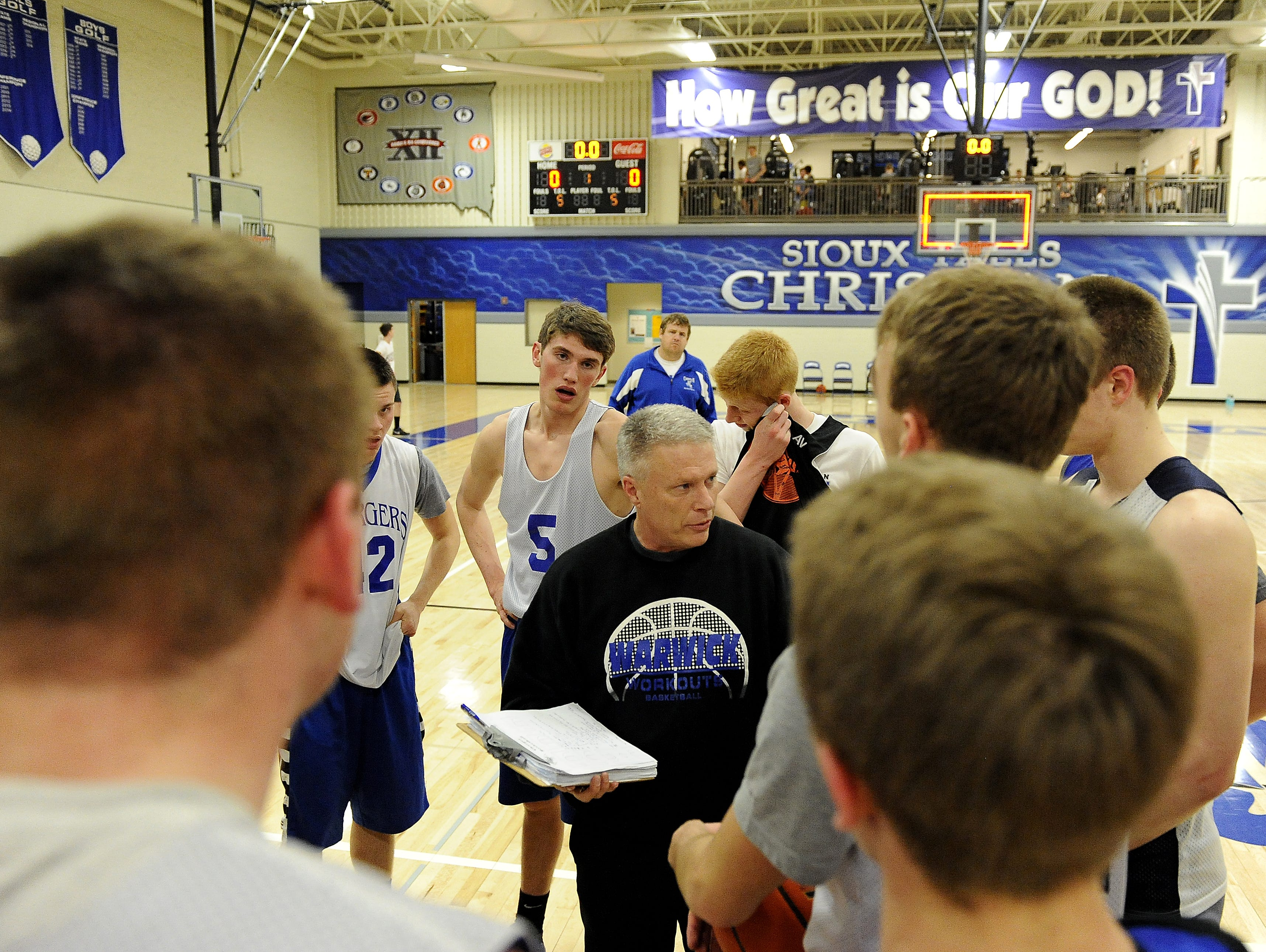Sioux Falls Christian's coach Mike Schouten talks with his team during basketball practice in Sioux Falls, S.D. Monday, March 14, 2016.