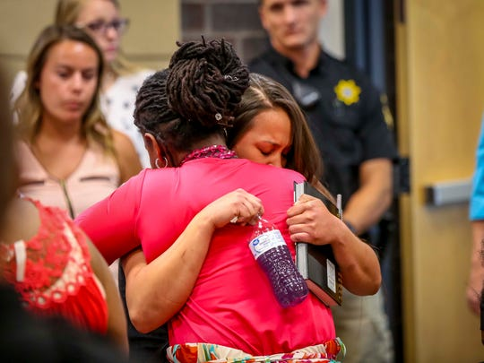 Melisa White hugs a family member of Calvin Curtis