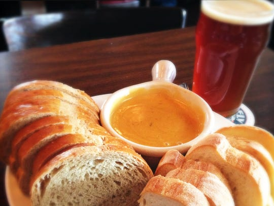 This beer-cheese crock at Broad Ripple Brewpub features two cheeses and two kinds of bread. It goes down easy with beer on draft.