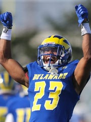 Delaware safety Nasir Adderley celebrates a takeaway.
