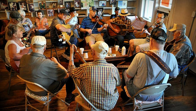 The Ozark County Historium in Gainesville will host an old-time music get-together at 10 a.m. Saturday, Feb. 24. The event, honoring Ozarks gatherings such as the McClurg music jam (pictured here), will begin with a discussion about old-time music and its place in local communities. Ozarks Alive! blogger Kaitlyn McConnell will lead the discussion that will feature several of the region's longtime musicians, including H.K. Silvey of Thornfield, Mo.,Alvie Dooms of Ava, Mo., and J.R. Johnston of Norwood, Mo., along with their younger protege, David Scrivner of Kissee Mills, Mo.After the discussion, the musicians will stay and play some of the old songs commonly heard in days gone by. This event is free and open to the public; seating will be available on a first-come, first-served basis. If the weather is bad, the event will be postponed to a later date. For more information, call the Historium at (417) 679-2400 or email janettaber@gmail.com