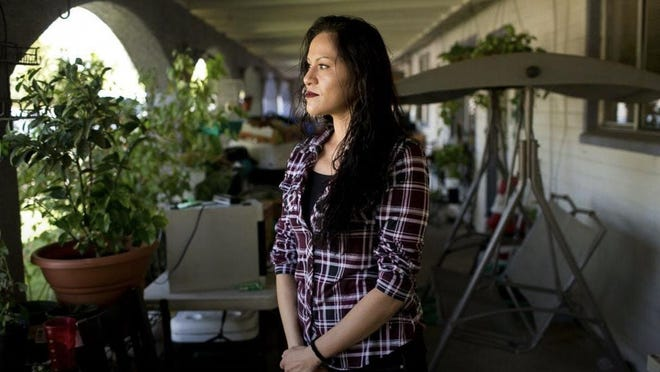 Elizabeth Franco now says she wanted to press charges against Phoenix officer who she says assaulted her in 2008, but she followed the advice of the detective who took her report and did nothing, since the officer has resigned. Thomas Hawthorne/The Republic