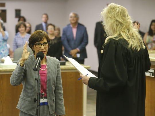 Cissy Lizarraga is sworn in as District 8 city representative in July 2017.