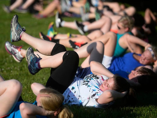 People kicked and punched along with Jen Kuhn as she led a kickboxing class for No Sweat in the Park.