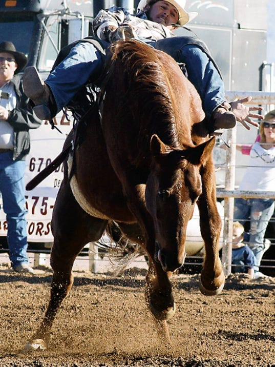 Bill Armendariz — Headlight Photo   Bareback riders usually have a rough go during the Wild, Wild West Pro Rodeo at Horseman's Arena in Silver City. The rodeo opens at 8 p.m. today for a three-day stay.