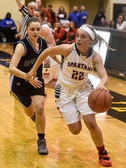 Pleasant's Kamryn Kimmel evades Bishop Ready's defense and makes her way to the basket during the Division III girls basketball district finals on Friday at Ohio Dominican University.