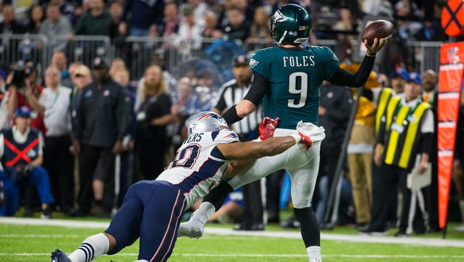 Eagles quarterback Nick Foles throws under pressure at US Bank Field in Super Bowl LII.