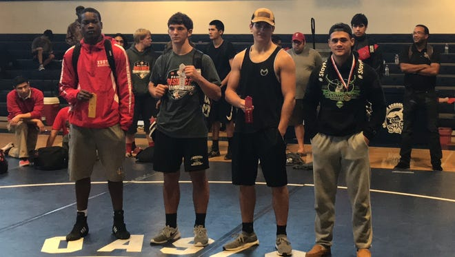 Lely senior Marlon Moreta, far right, won the 170-pound championship at the recent district meet held at Cape Coral-Oasis Charter.