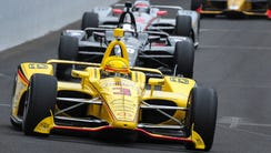 Team Penske IndyCar driver Helio Castroneves (3) leads