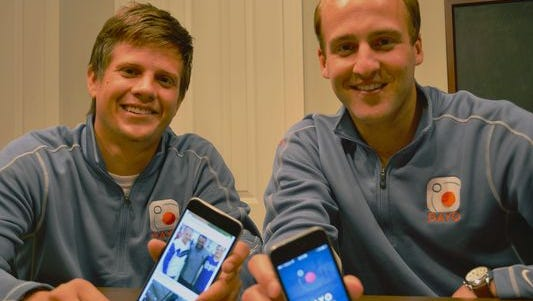 Michael Gaeddert, left, a Purdue North Central graduate, and Michael Miller, a Ball State University graduate, display the photo sharing app they launched in February. Called Dayo, the app creates and posts albums, telling a more complete story of a user's day than single moments spread across a news feed.