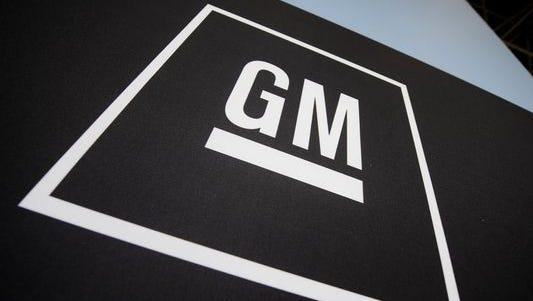 This April 8, 2009 file photo shows the General Motors logo displayed at the New York International Auto Show in New York.