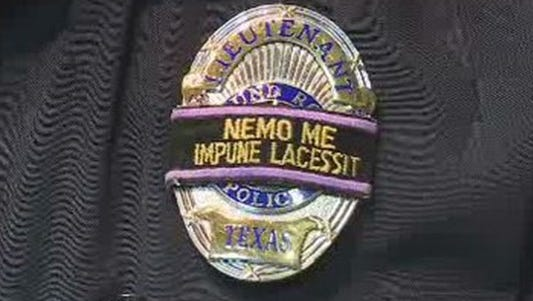Black band over a Round Rock Police Department badge.