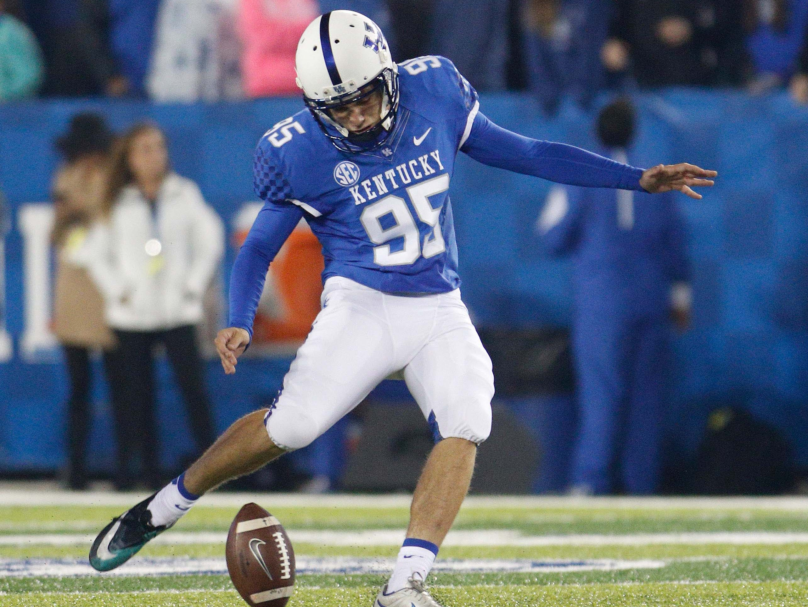 Oct 3, 2015; Lexington, KY, USA; Kentucky Wildcats kicker Miles Butler (95) kicks the ball off during the game against the Eastern Kentucky Colonels at Commonwealth Stadium. Kentucky defeated Eastern Kentucky 34-27 in overtime.