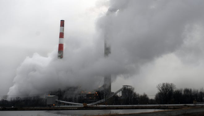Emissions are shown coming from the Indianapolis Power & Light Co. power plant on Harding Street in this 2009 photo. The coal-fired plant is undergoing a $70 million conversion to burn natural gas, considered a cheaper and somewhat cleaner fuel, by the spring of 2016.