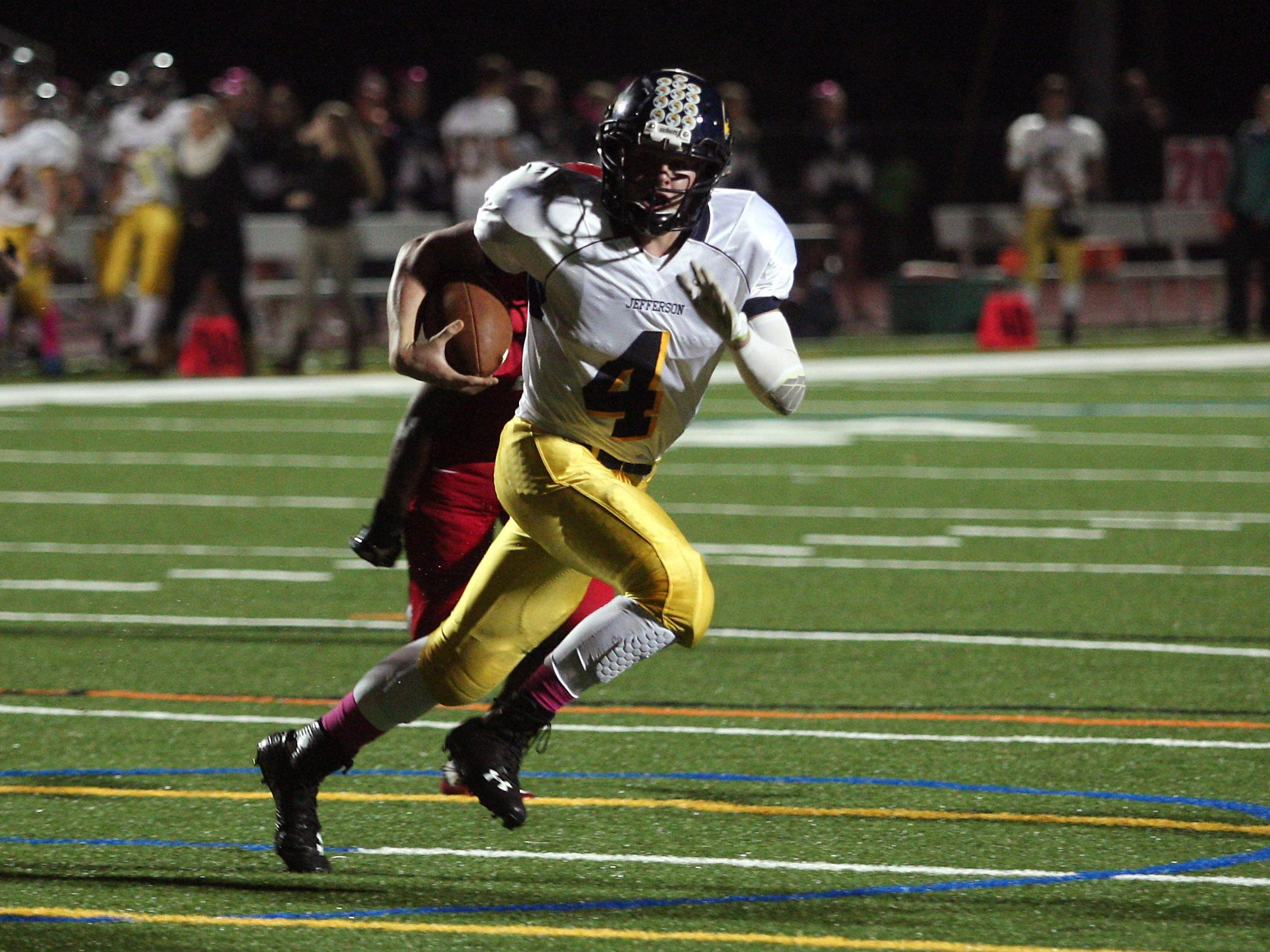 Jefferson quarterback Logan Holleritter rushes on a keeper against Parsippany on Friday night.