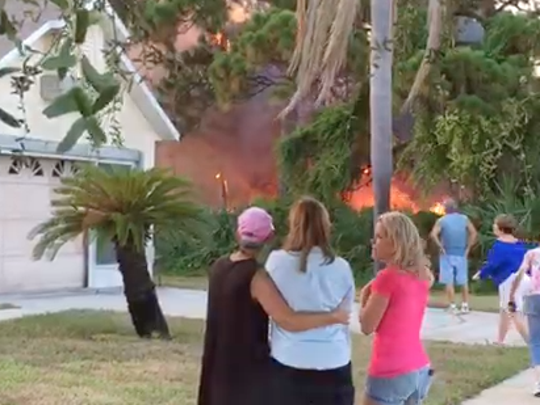 Fast-moving fire threatens homes in Suntree.