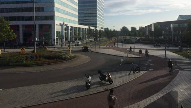 A photo taken from the natural water level above a square in the Dutch city of Almere. The city was built on land reclaimed from the Zuiderzee and is protected by dikes and other water defenses. The United States faces a coastal threat with rising sea levels due to global warming. But the Netherlands provides lessons in how to adapt and live with the water.