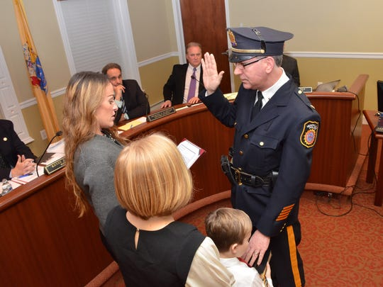 Verona Police Department Chief Mitchell Stern is officially sworn into his role during a council meeting Dec. 8, 2015.