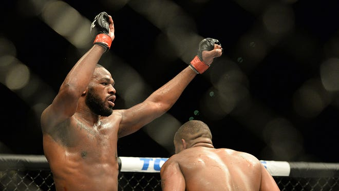 Jon Jones (red gloves) and Daniel Cormier (blue gloves) compete during their light heavyweight title fight at UFC 182 at the MGM Grand Garden Arena. Jones won.