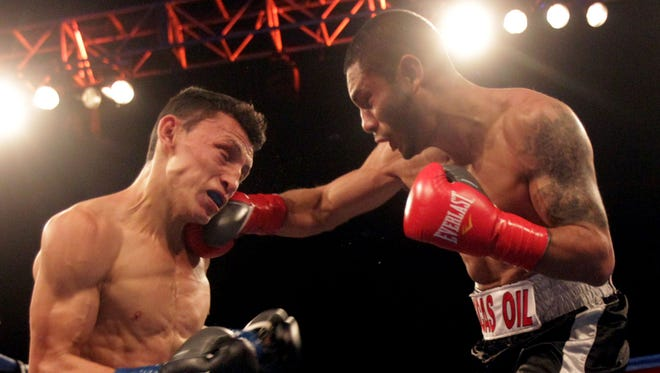 At left, Rene Alvarado of Nicaragua receives a right hook from Andrew Cancio of Blythe, California during their bout at Fantasy Springs Casino. Cancio won in round 8th via TKO.