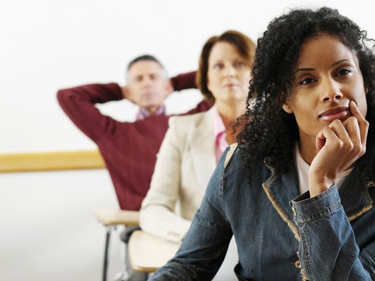 adult students paying attention in class